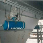 Hopper with compressed air sootblower